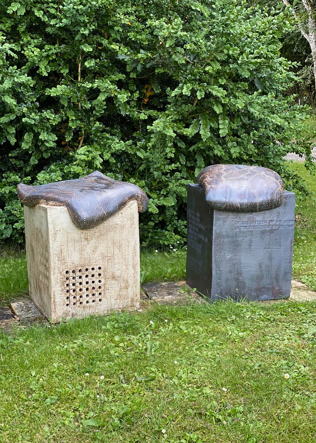 Two sculpture chairs on a lawn